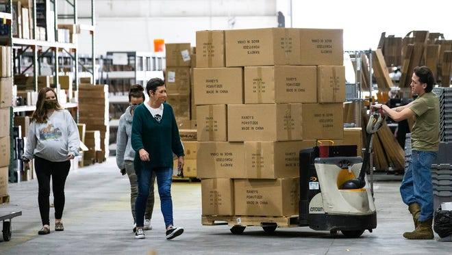 Nate Negron restocks shelves Thursday in the warehouse of an Ocala truck parts business that has hired 10 more people to handle online orders since the coronavirus pandemic started. Florida officials celebrated businesses like that as they announced statewide drops in unemployment Friday.