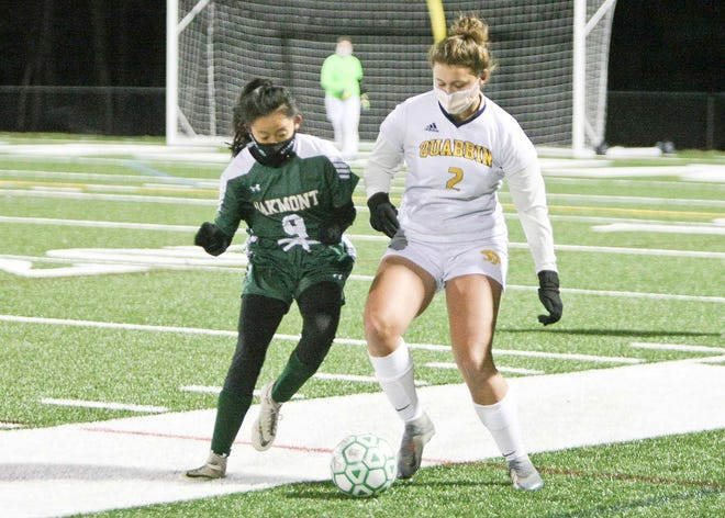 Oakmont senior Ellie Briggs moves in to try and take the ball away from Quabbin's Amy Stauder (2) during Thursday night's game at Arthur I. Hurd Memorial Field in Ashburnham. Biggs was one of eight Spartans seniors recognized after the game as Oakmont celebrated Senior Night.