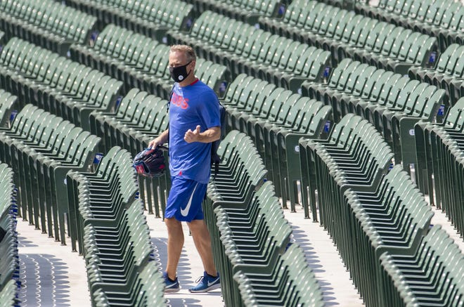 The Cubs' jed Hoyer walks out to the field for a workout at Wrigley Field on July 6. He was promoted from general manager to the team's president earlier this week. [Brian Cassella/Chicago Tribune/TNS]