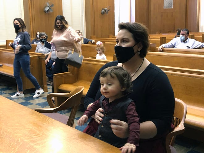 Nikki Silva holds her son Grayson in the East Courtroom at the Grayson County Courthouse Friday just moments before his adoption was finalized.