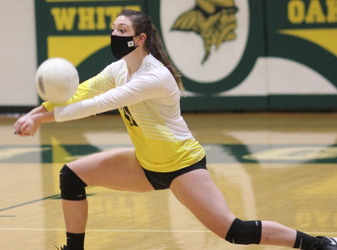 Senior Ily McElyea is in her first year attending and playing volleyball at White Oak after she was homeschooled the last five years. [Chris Miller / The Daily News]
