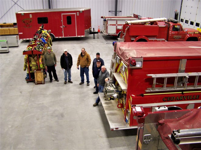 Firefighters stand in the new Cedarville Fire Protection District station on Illinois Route 26 in Cedarville.