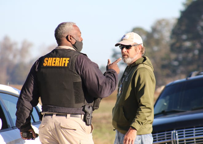 Lenoir County Sheriff Ronnie Ingram talks to a law enforcement agent Friday morning, November 20, on Kennedy Home Road with officers pursue Robert Lee Strother.