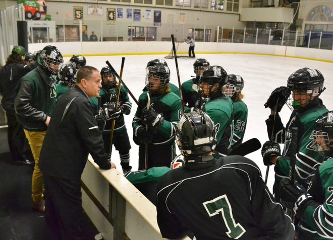 Coach Rich Cinalli talks to his players during a game against Brush last season. Nordonia will play in the Blue North Division this winter