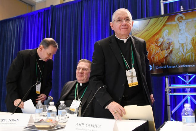"""In this Tuesday, Nov. 12, 2019, file photo, Archbishop Jose H. Gomez, right, of Los Angeles, with Bishop Michael F. Burbidge, left, of Arlington, Va., and Cardinal Joseph William Tobin, of Newark, N.J., exits a news conference after being elected president of the United States Conference of Catholic Bishops during their Fall General Assembly in Baltimore. Gomez congratulated Joe Biden on his presidential election victory. Now, Gomez is sounding a different tone, saying some of Biden's policy positions, including support for abortion rights, pose a """"difficult and complex situation"""" for the church."""