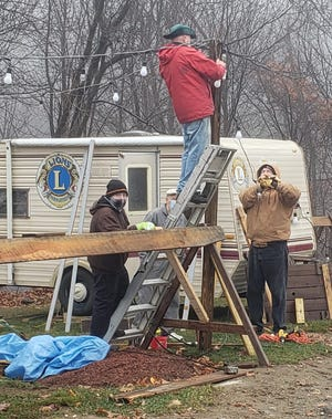 Members of the Rutland Lions Club set up stands for their upcoming Christmas tree sales.