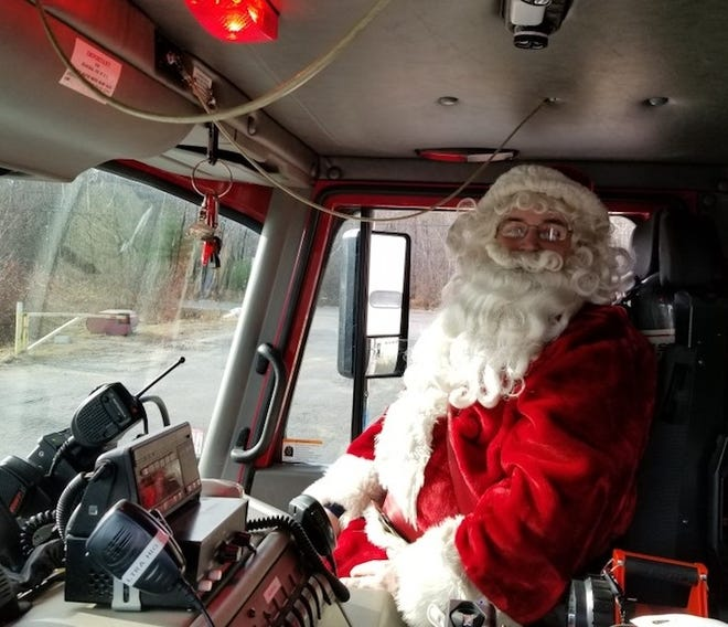 Santa Claus, an honorary member of the Princeton Fire Department, delivered toys in town in 2019.