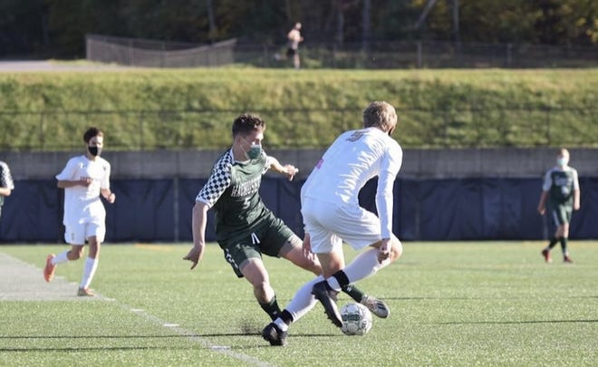 Wachusett Regional High School senior Thomas Raeke fights for the ball during a soccer match.