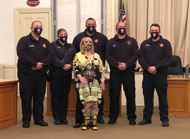 From left, FF/Paramedic Chris Montiverdi, FF/Paramedic Katie Goulding, FF/EMT Eric Fasshauer, FF/EMT Ryan Casper and FF/Paramedic Trevor Olson. In front are Kim McLaren and her son, Max.