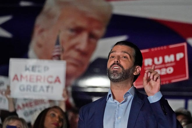 Donald Trump Jr., gestures during a Nov. 5 news conference at Georgia Republican Party headquarters in Atlanta. A spokesman said President Donald Trump's eldest son has been infected with the coronavirus.