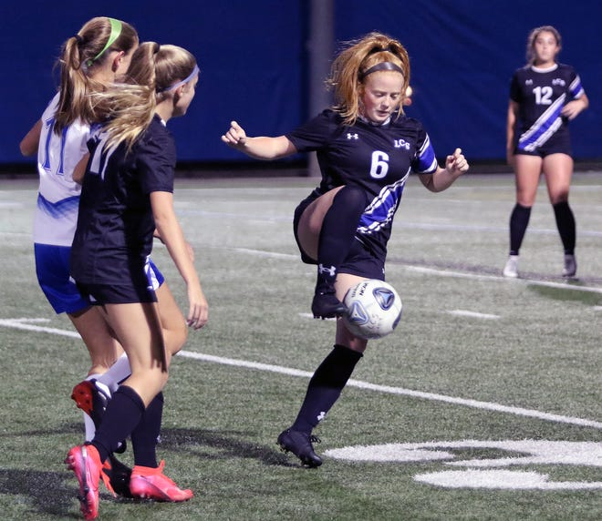 Lakeland Christian's Emma Riggs controls the ball in the midfield against Auburndale on Thursday night. She had a goal and an assist in the Vikings' 3-1 victory.