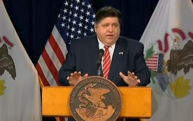 Gov. JB Pritzker speaks at his daily COVID-19 briefing in Chicago Thursday, calling on House Speaker Michael Madigan to either take questions from members of the media or resign.