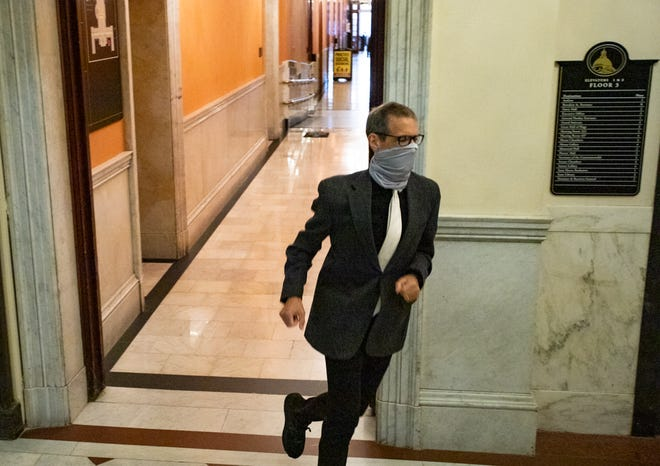 State Sen. Will Brownsberger, D-Belmont, runs back to the Senate Chamber during a roll call Wednesday to cast a vote. After months of monitoring the economy, lawmakers burst into action for unprecedented back-to-back weeks of budget debate.