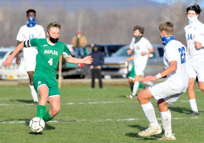 Ryan Lester (4) of Naples is part of the stingy defense that helped the Big Green win a Section V title last fall.