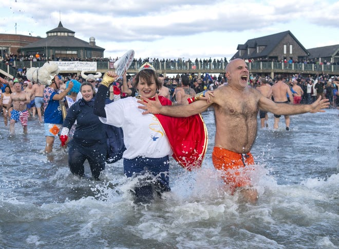 Thousands of people usually crowd Easton's Beach in Newport on New Year's Day for the Polar Plunge, but that will not be the case this year.