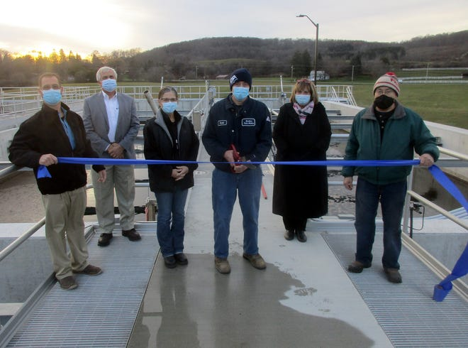 MRB Group's William Davis, far left, joins Hamilton village officials, from left, Jim Stokes, Nancy Mitchell, David Jordan, RuthAnn Loveless and John Basher Nov. 19 for the official ribbon cutting at the village Wastewater Treatment Plant off College Street. The plant has seen $13.4 million in updates to allow for future growth in the village.