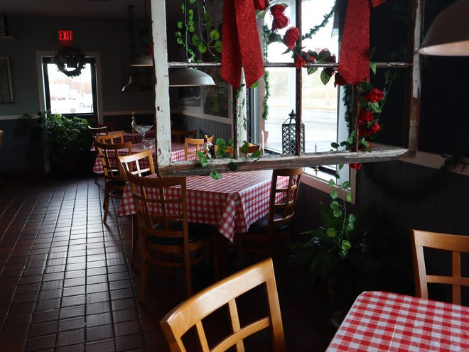 Rintrona's Bistro is decorated for the holidays Thursday, Nov. 19, 2020, in South Utica. The Italian restaurant and sports bar opened in the midst of the coronavirus pandemic this summer.
