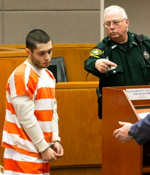 Sky Bouche makes his way to the podium during a January court appearance. He is scheduled to stand trial this Spring.