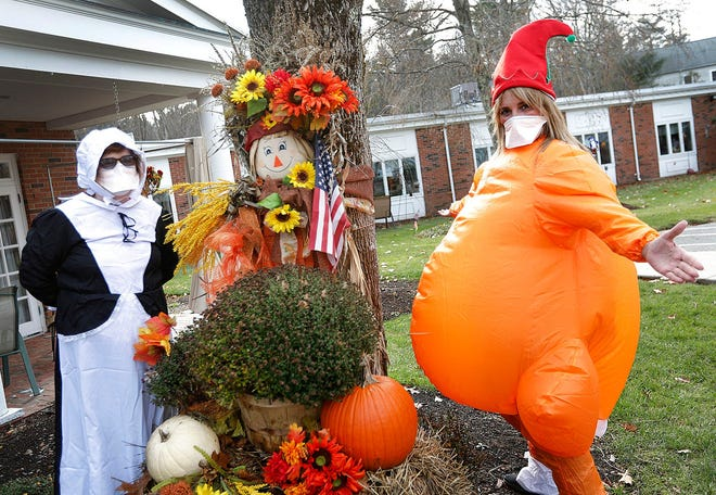 Stacey Healy, right, activities director at the Queen Anne Nursing Home in Hingham, dressed as a turkey for Thanksgiving with her assistant Carol MacArthur, dressed as a Pilgrim.