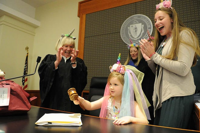 Charlotte Goldman, sister Danni Goldman, and judge Mary McMallum, during  National Adoption Day at Brockton District Court on Friday, Nov. 16, 2018.