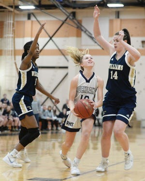 Rockland's Hannah Murphy drives the lane between Archbishop Williams defender from left, Camille Minor, and Jessica Knight, during their game versus  on Friday, March 6, 2020.