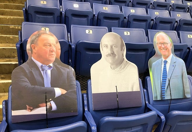 Cardboard cutouts in the stands at the University of New Hampshire's Whittemore Center for the 2020-21 season include, from left, men's hockey coaching legend Dick Umile, women's hockey coaching legend Russ McCurdy and current UNH President James Dean.