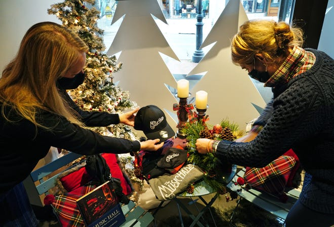 Ashleigh Tucker Pollock, chief of staff at The Music Hall, left, works with Kate Malloy, chief of design and culture at Malloy Events, for a unique Holiday Shoppe at The Loft, located at 131 Congress St. in Portsmouth. The shop will offer custom branded merchandise and gifts along with pre-ordered, ready-to-go floral arrangements for holiday decorating.