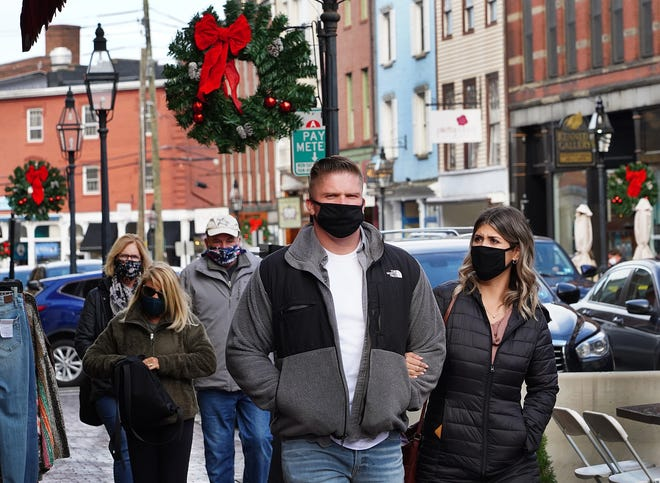 People wear facial coverings while walking around Market Square in Portsmouth. The Seacoast Chamber Alliance has launched a Seacoast Safe initiative to demonstrate local businesses' commitment to the health and safety of their communities.