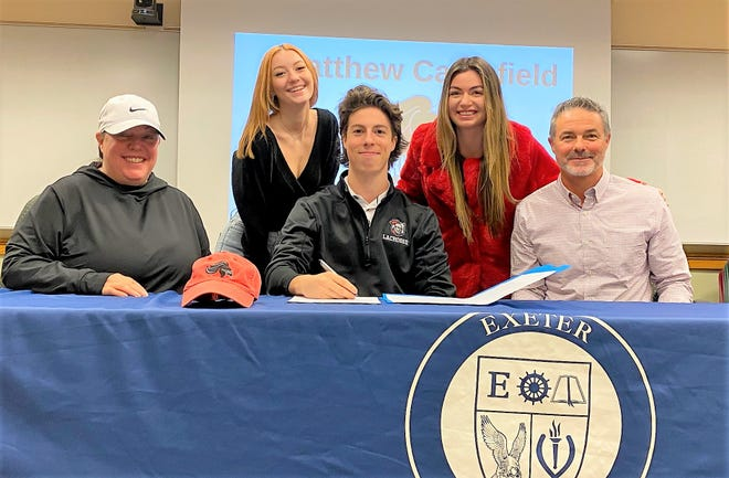 Exeter High School senior Matthew Campfield, center, signed his National Letter of Intent on Wednesday to play men's lacrosse Belmont Abbey College, a Division II program in North Carolina. With Matthew, from left, is his mother, Kym, sisters Kylie and Ella, and father, Don.