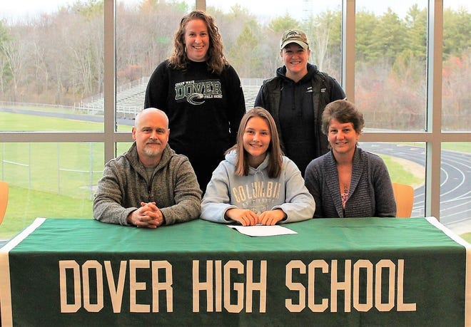 Dover High School senior Jeannine Turgeon signed her National Letter of Intent on Thursday to attend and play field hockey at Columbia University. She is pictured, in the front, with her parents, Kevin and Paula, as well as Dover head coach Sarah Michaud, back right, and assistant coach Jessi Paul.