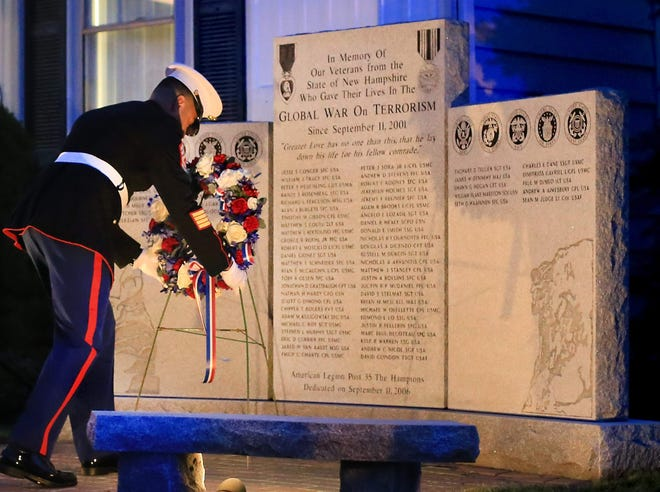 In this 2018 photo, U.S. Marine MSgt. Mario Real places a wreath at the Global War on Terrorism Monument in Hampton on Sept. 11 that year. Four names were added to the monument in 2018.