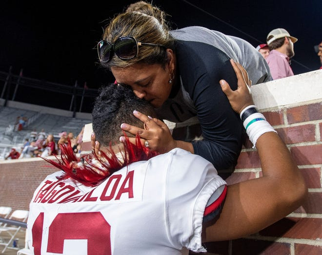 Tua Tagovailoa credits his mother, Diane Tagovailoa, with instilling a sense of peace and calm in his every day approach to life. This photo was taken after an Alabama game in 2018.