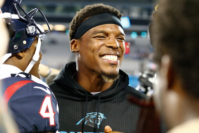 Former Carolina Panthers quarterback Cam Newton talks with Houston Texans quarterback Deshaun Watson after a game at Bank of America Stadium in 2017.