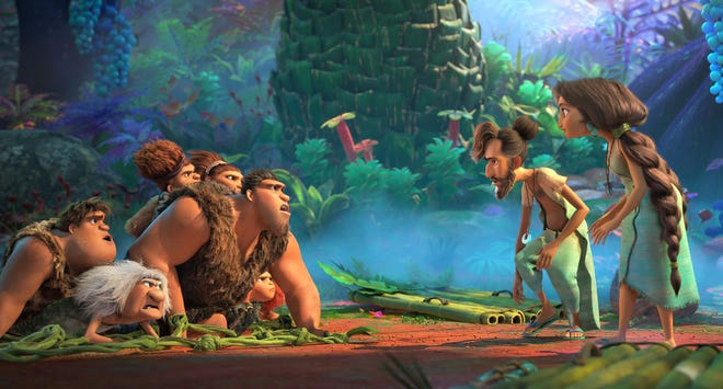 """It's the Croods, left, versus the Bettermans in """"The Croods: A New Age,"""" directed by Joel Crawford."""