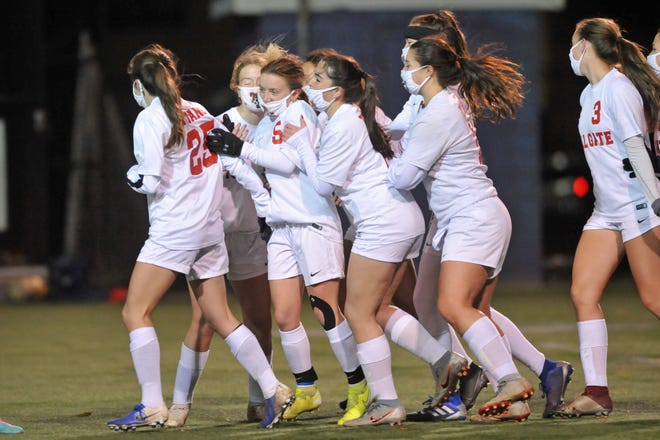 The Toll Gate girls soccer team mobs Olivia Dutra (5) after she scored in the second half of Thursday's 3-0 win over Classical in the Division III semifinals.