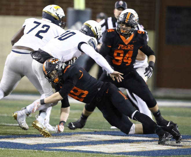 Massillon's Caiden Woullard sacks Hoban quarterback Shane Hamm in the first half of the 2019 Division II regional final at the University of Akron. (IndeOnline.com / Kevin Whitlock)