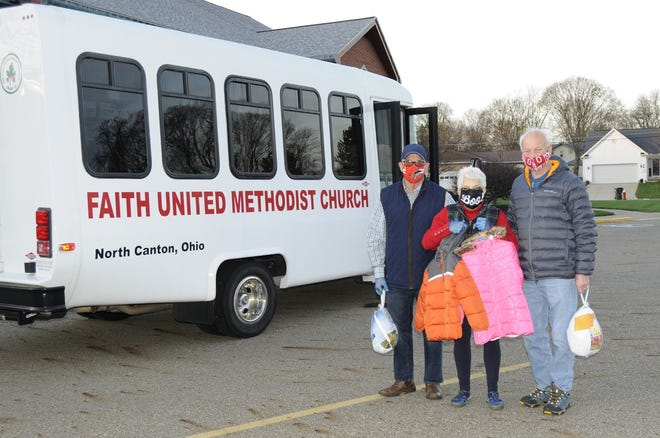 Faith United Methodist Church in North Canton recently donated holiday items for 160 families of students at  Patrick Elementary School in Canton. Pictured are (left to right) Mac Mclaughlin, Judy Mclaughlin, and Glen Froelich.