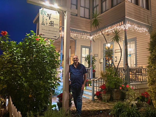 Anthony Sexton, co-owner of the Victorian House Bed and Breakfast on Cadiz Street, stands in front of his St. Augustine establishment on Thursday night.