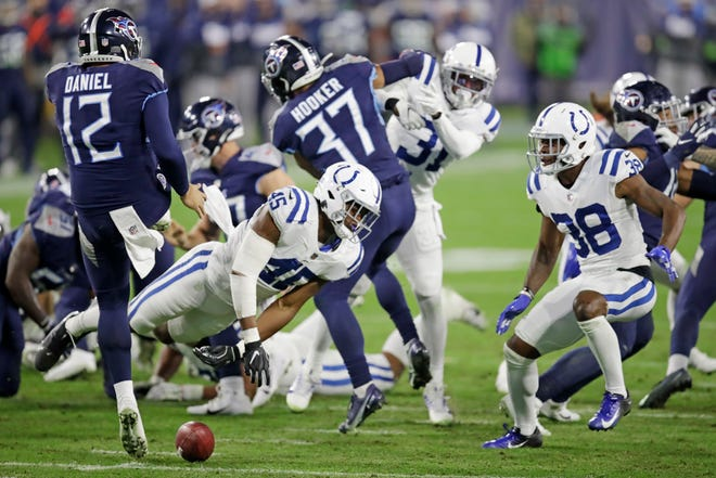 Indianapolis Colts linebacker E.J. Speed (45) blocks a punt by Tennessee Titans punter Trevor Daniel (12) in the second half Nov. 12  in Nashville, Tenn. Colts cornerback T.J. Carrie (38) recovered the ball and ran it back for a touchdown.