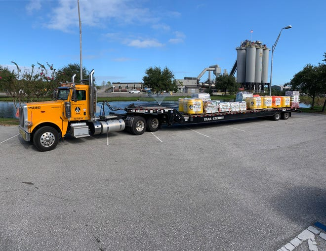Ajax Paving Industries collected 21,042 pounds of donated food Friday at its Fill that Truck Food Drive.