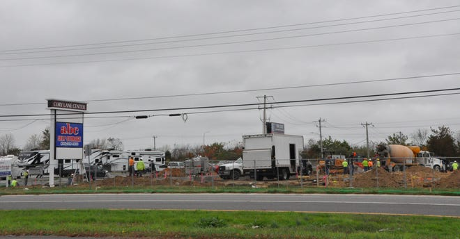 Construction crews work on the Firestone Complete Auto Care center on northbound U.S. Route 13 in Smyrna near Waffle House the morning of Nov. 11.