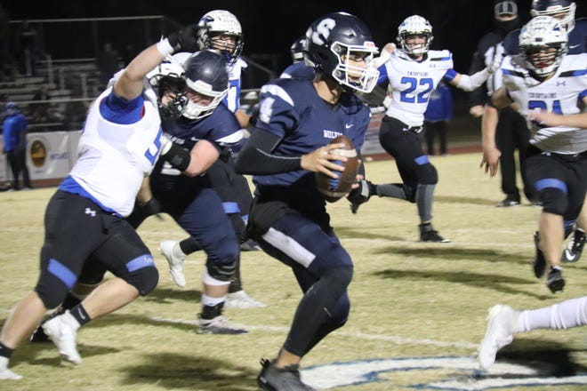 Shawnee quarterback Karsen Conaway (4) prepares to make a pitch during the Wolves' 35-34 home victory over Sapulpa last Friday in the first round of the Class 5A playoffs.