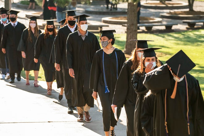 OBU graduates take The Walk before the Spring Commencement ceremony held Aug. 1.
