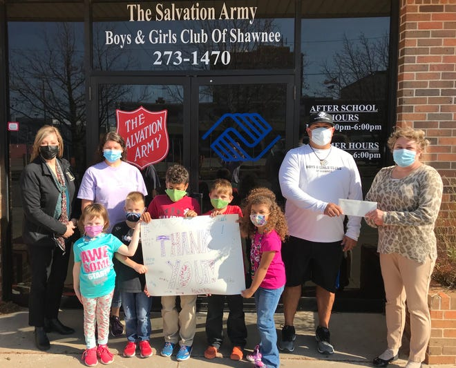 Pictured with club members, from left, are Kathy Laster, president and CEO of the Avedis Foundation; Kira Howard, assistant director of the Salvation Army Boys and Girls Club; Julio Sanchez, club director; and Tracy Meeuwsen, Avedis program director.