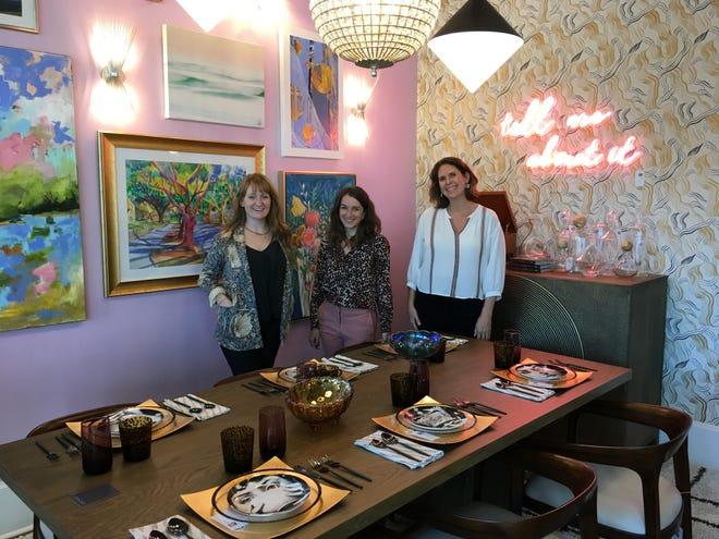 Big Sky's Rileigh Wilkins (left), Lauren Brown, and Jennifer Kraner stand in the business' new retail studio space. [ALLISON BALLARD/STARNEWS]
