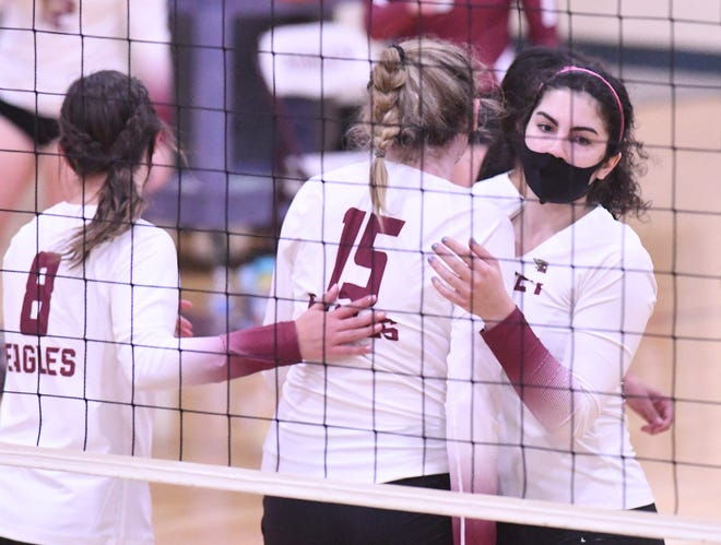 Ashley comes together after scoring a point as Ashley beat Hoggard 3-2 in volleyball Thursday Nov. 19, 2020. [KEN BLEVINS/STARNEWS]