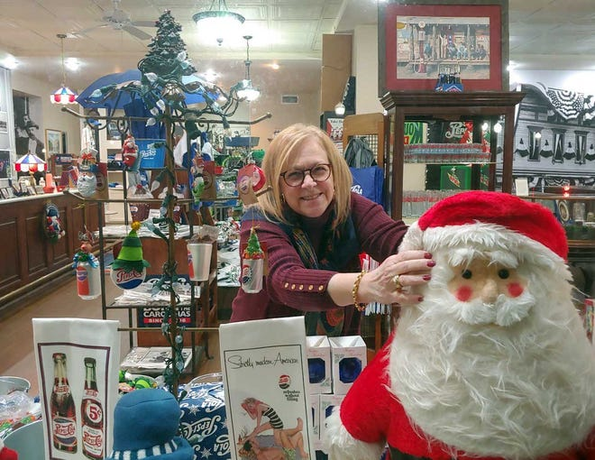 Sabrina Bengel of The Pepsi Store on Middle Street in New Bern works on window displays for Black Friday and the upcoming Christmas shopping season.