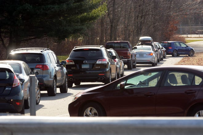 Some of dozens of cars lined up for COVID-19 testing at Dodd Stadium in Norwich Friday. [John Shishmanian/ NorwichBulletin.com]