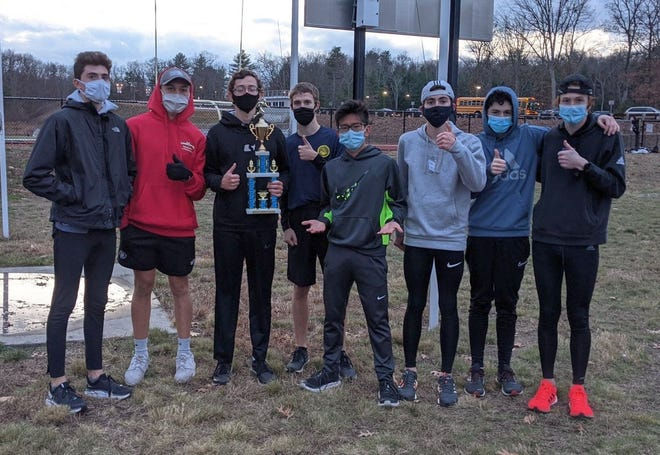 Members of the Uxbridge boys' cross-country team pose with the Pod 3 championship title Tuesday in Uxbridge.