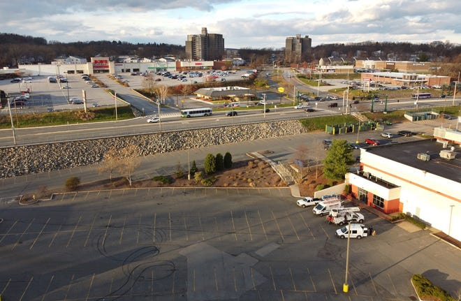 This aerial shot, taken Thursday, shows Worcester Housing Authority buildings and retail plazas on land that was once home to Lincoln Country Club.